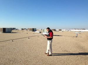 A technician from Sheridan, Ark.-based RoofConnect walks a roof and documents it as part of an annual maintenance survey. RoofConnect, which has locations around the country, including Monroe, N.C., has made maintenance contracts a major part of its business.
