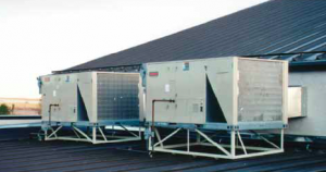 A frame-mounted HVAC unit can be supported without roof penetration by using seam clamps.