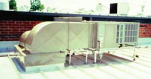This frame-mounted HVAC unit uses pipe supports that extend to the building structure and are flashed through the roof using rubber pipe.