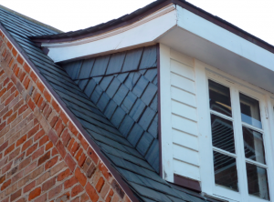 This dormer features Vermont Black installed in a German style.