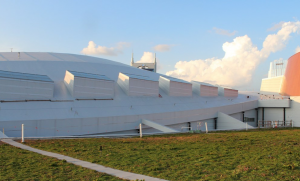 Because the green-roof portion is confined to the middle of the roof, transporting dirt from the loading point would require traversing completed roof sections, increasing the odds of damage.