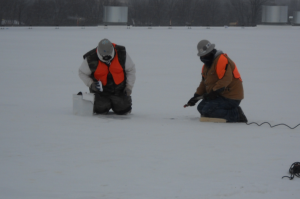 Windburn and frostbite can set in very quickly if roofing workers are not adequately dressed for cold weather. These workers are properly dressed.