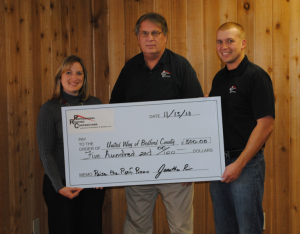 "Dawn Holley, executive director of United Way of Bedford County, receives a check for $500 from Larry Price (middle), president, and Jonathan Price, vice president of Professional Roofing Contractors, Shelbyville, Tenn. The roofing contracting company donated $5 to United Way of Bedford County for each ""like"" added to its Facebook page while collecting entries for a charitable roof giveaway."