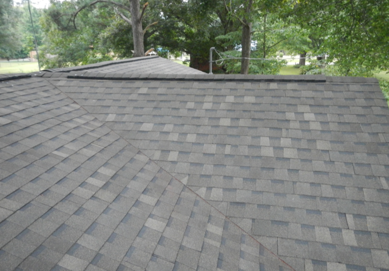 Jo Gentle's new roof with materials donated by Atlas Roofing and labor donated by Professional Roofing Contractors.