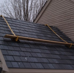 Roof bracket allows staging of materials without covering for Roof covering materials