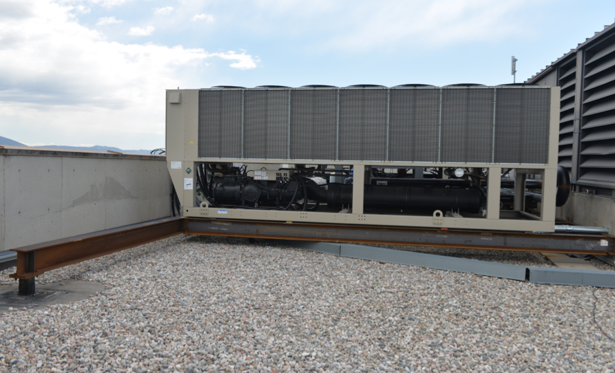 Wind loading on rooftop equipment roofing