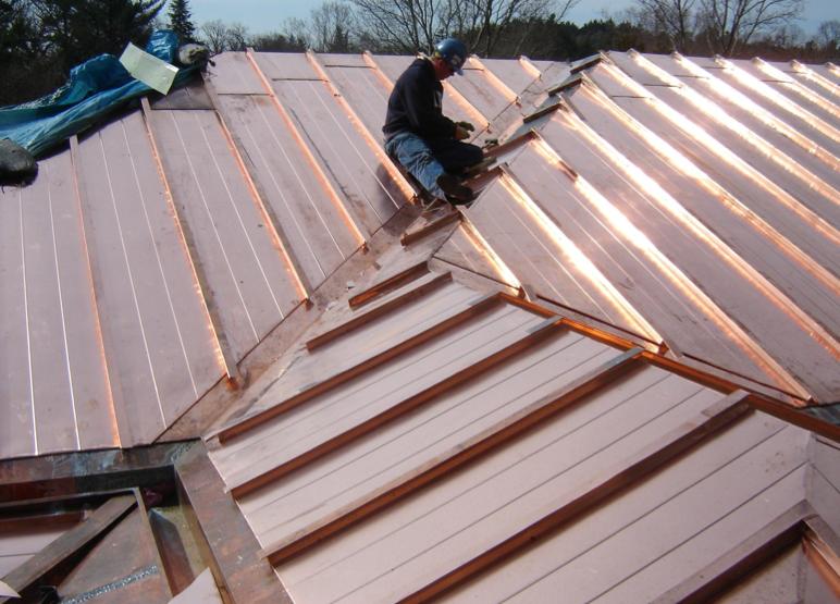Having one of the largest copper roofs in the country, the historic Kingswood High School, Cranford, Mich., recently underwent a massive $14 million roof-restoration project. The copper-clad roof is comprised of batten seams on the upper slopes, interior gutter with internal rainwater conductors, and standing- and flat-seam panels on the eaves. An embossed copper fascia and copper soffit panels complete the system. PHOTO: QUINN EVANS ARCHITECTS