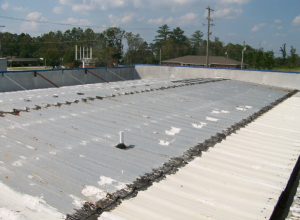 Caulk, roof coating and tar patches were used to cover leaking fasteners and panel end laps.