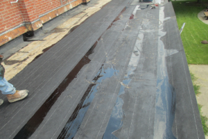 To seal two-ply asphaltic felts set in hot asphalt on a concrete roof deck, an asphaltic glaze coat was applied at the end of the day. Because of the inherent tackiness of the asphalt until it oxidizes, Hutch has been specifying a smooth-surfaced modified bitumen cap sheet, eliminating the glaze coat.