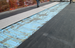 Fleece-back EPDM set in full-coverage spray foam on a concrete roof deck provides a superior vapor retarder without the use of torches or asphalt. It also can be integrated in the roof system's and manufacturer's warranties.