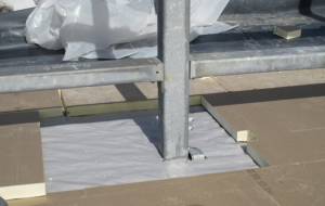 Sealing penetrations and lap joints can be challenges of polyethylene vapor retarders, especially over corrugated metal roof deck if sheet-metal backing is not specified.