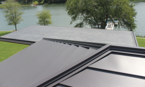 To create a more contemporary look for the roof, Kersting specified that the aluminum be installed up and over 2 by 4s at all hips and ridges.