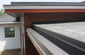 The Bermuda roof areas have a fabricated sheet-metal box gutter and the EPDM roof sections were all constructed with a built-in gutter at the eave.