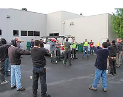 """Employees in the field perform a """"Stretch and Flex"""" activity every morning, led by the foreman, to help prevent injuries."""
