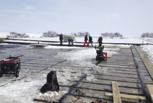 The harsh Chicago winter of 2013- 14 didn't stop Trinity Roofing Service from completing the twoyear project on schedule. Seven miles of backer rod are being laid between seams of concrete roof channels despite snow and ice.
