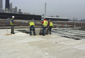 Sixty-six different types and sizes of precast concrete roof channels, weighing between 225 and 600 pounds, were hoisted by a modified crane. All 30,000 had to be inspected and approved before installation.