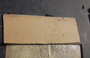 3. This layer of high-density board had no attachment whatsoever to the concrete roof deck. Notice the sprayfoam adhesive is fully cured and did not attach to the substrate board.