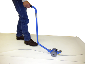 Everhard Products Inc.'s Standup Membrane Slitter allows roofing workers to work on their feet rather than hands and knees.