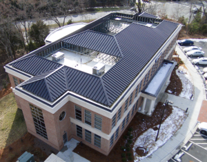 The roof consists of 60-mil TPO membrane fully adhered on low-slope areas and System 2500 mechanically seamed standing-seam panels on the steep-slope areas.