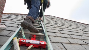 The SLATOR tool fastens to a steep slate or asphalt shingle roof and firmly clamps a ladder into position.