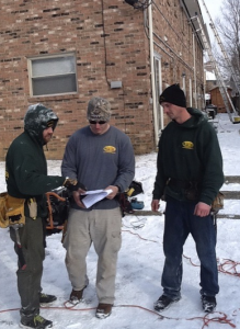 Grant Smith (middle), a former U.S. Infantryman in the Marine Corps, was hired as an installer by Muth & Co. Roofing, Westerville, Ohio, through Hiring Our Heroes. Just two years later, he is a field supervisor.