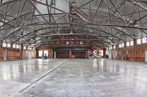 The hangar is a unique historical building; therefore, the designer wanted to keep the heritage of the building intact while transforming it into an elegant, updated and functional facility.