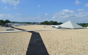 PHOTO 2: This recently installed, ballasted, 90-mil EPDM roof was designed for a 50-year service life.