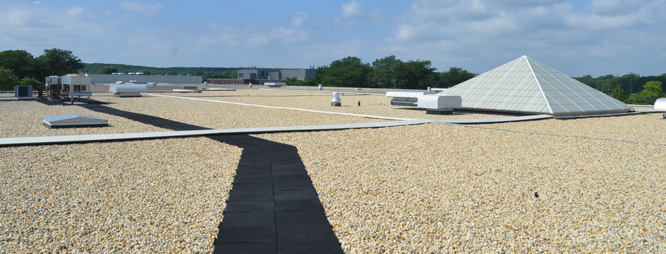 This recently installed, ballasted, 90-mil EPDM roof was designed for a 50-year service life.