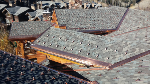 The concrete tile roof and poorly ventilated deck were causing major problems for the building owner, not to mention the residents who live and rent there. Heat was escaping through the roof, causing the snow to melt and refreeze at the eaves.
