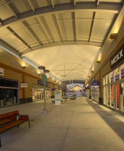 The largest open-air outlet mall in Canada features approximately 23,000 square feet of PTFE fiberglass membrane walkway canopies.
