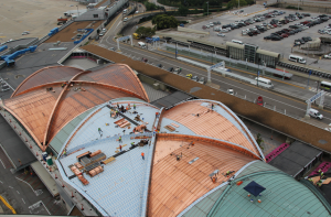 CopperPlus was installed in stages over the domes at Lambert-St. Louis International Airport. Like solid copper, copper-clad stainless steel acquires a patina over time.