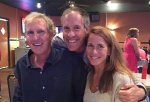 Her Roofing family was in attendance (shown here at the rehearsal dinner). From left to right: John Riester, vice president of business development; Barrett Hahn, publisher, who served as the wedding photographer; and Becky Riester, who was a bridesmaid.