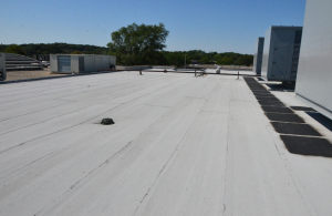 The owner preferred a granule-surfaced modified bitumen roof system for durability against repeated foot traffic.