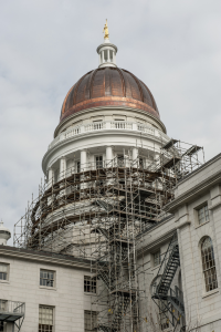 To remain proportional with the larger building, a new, higher copper-covered dome was built to replace the original cupola.