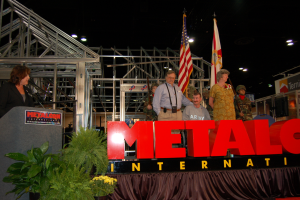 At the 2006 METALCON, Show Director Claire Kilcoyne presented a new steel-framed ADA-compliant home to U.S. Army Staff Sgt. Paul Russell Marek of Satellite Beach, Fla. Marek's parents, Paul and Rose Marek, were there to help him accept the home.
