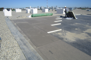 PHOTO 4: On this roof, the existing loose-laid membrane was removed, open insulation joints filled with spray-foam insulation and new insulation added to meet current code requirements. A new 90-mil EPDM membrane was installed and existing ballast moved onto it to 10-pounds-per-square-foot coverage.