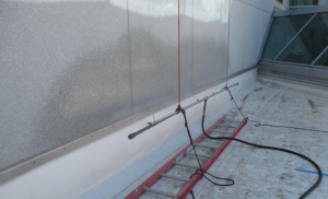 The team first sprayed the exposed base flashings with water, then rose up to the counterflashing, then further up the wall, then to the sill of the windows above, etc. Testing moved laterally to a new position before starting again.