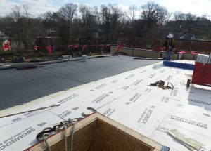 The roof systems incorporate multiple layers of polyiso insulation—a base layer of 6 inches and then tapered insulation on top of that for an average R-80.