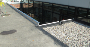 Note how nicely a prefabricated roof curb quickly and structurally raises the roof edge to accommodate new roof insulation.