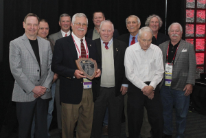 Gooding is surrounded by previous J.A. Piper Award winners.