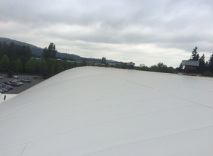 Because of the steep slope of this roof, the Columbia Roofing & Sheet Metal crew installed 60-mil Sureweld HS (High Slope) TPO.