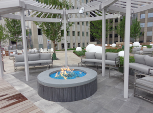 The rooftop transformation is highlighted by a fully wired amphitheater, fire-pit lounge and a small lawn accompanied by a new 12,000-square-foot fitness center and a 7,000-square-foot clubhouse located inside.