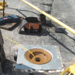 PHOTO 1: Roof drains should be set into a sump receiver provided and installed by the plumbing contractor.