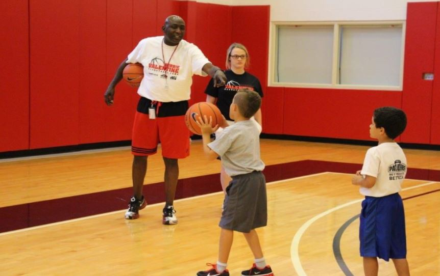 Robbie Valentine instructs campers during the annual Valentine Basketball Camps in Louisville.