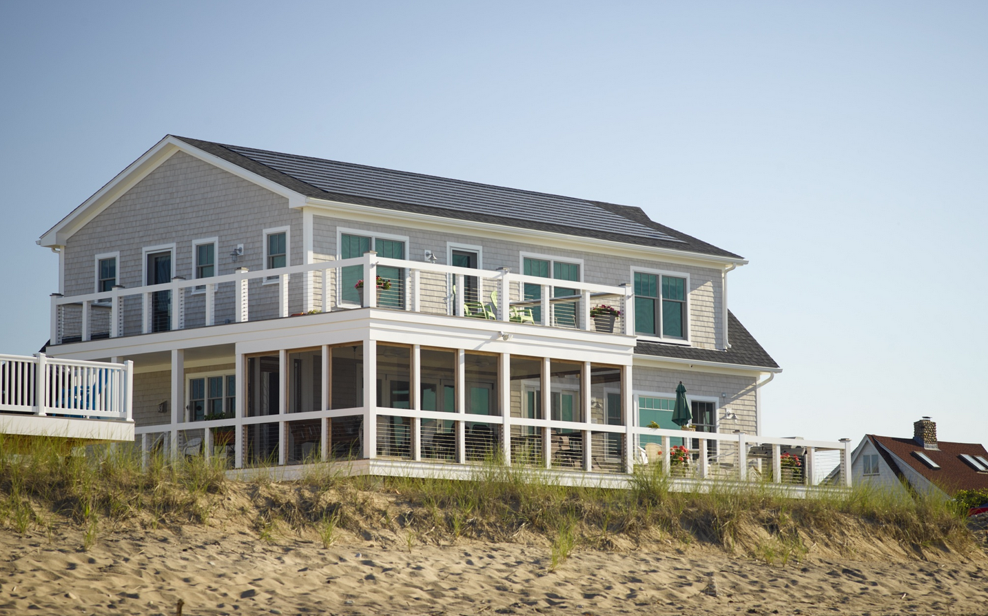 a sustainable coastal home—a complete rebuild of a home destroyed by Hurricane Sandy—in Westerly, R.I., will survive the next major storm.
