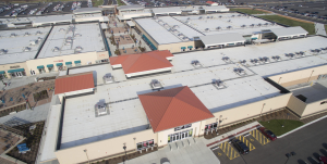 The majority of the roof surface features white TPO and the gallery roofs connecting the main buildings were tan; some canopies over walkways are gray.