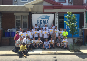 International Roof Coatings Conference attendees volunteered to apply reflective roof coatings to 18 row homes in north Philadelphia.