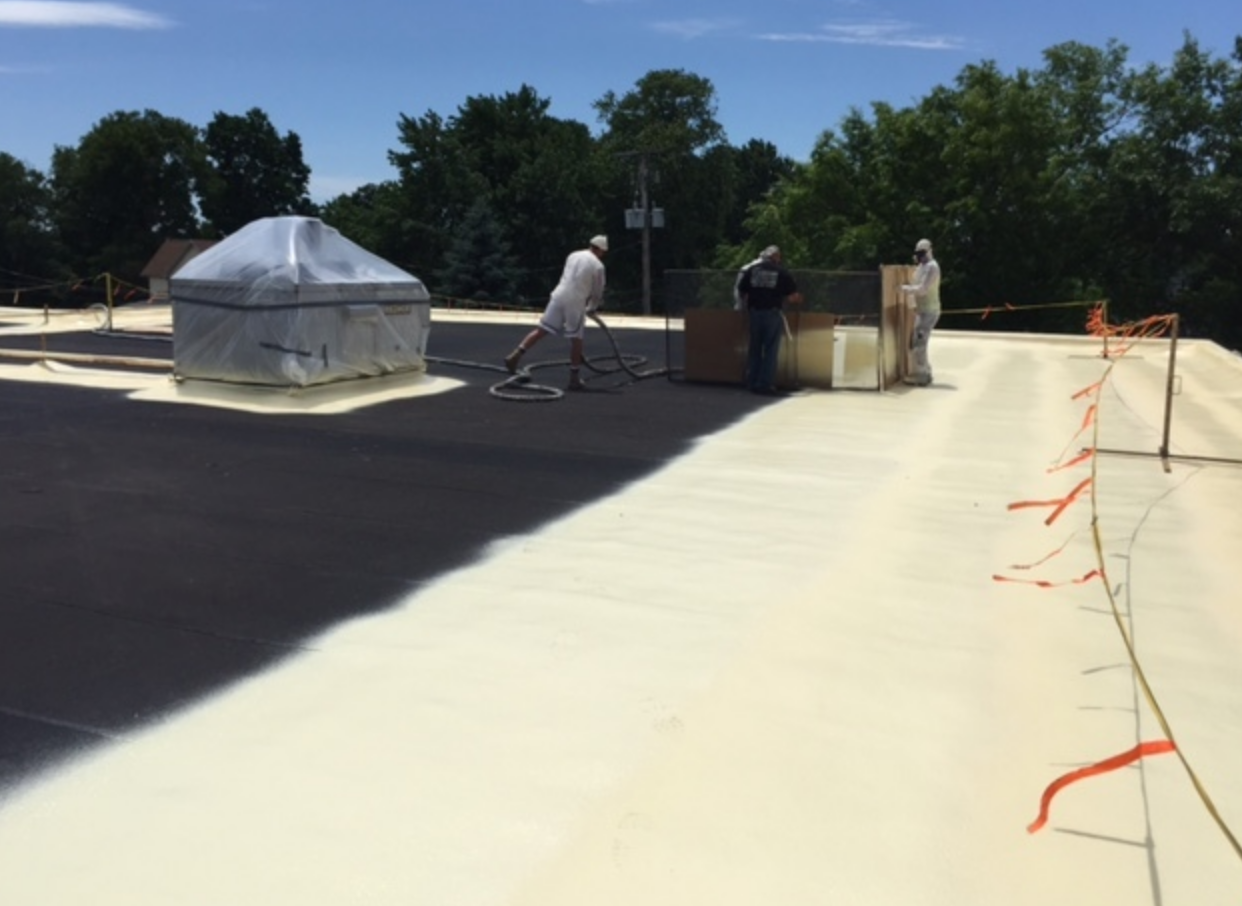 The existing roof experienced areas of ponding water that were remedied with spray foam that created a slope toward drains.