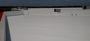 The J Reynolds & Co. Inc. team decided that a rejuvenation with a roof coating system and fluid-applied walk pads was the best solution for the project.