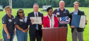 Congresswoman Sheila Jackson presents NCI a flag that was flown over the U.S. Capital building and a Certificate of Congressional recognition during National Manufacturing Day.
